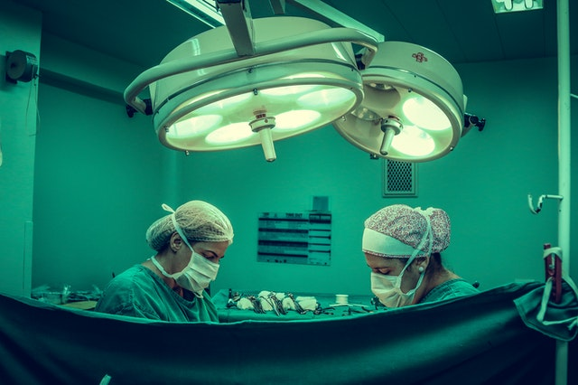 two surgeons in an operating theatre